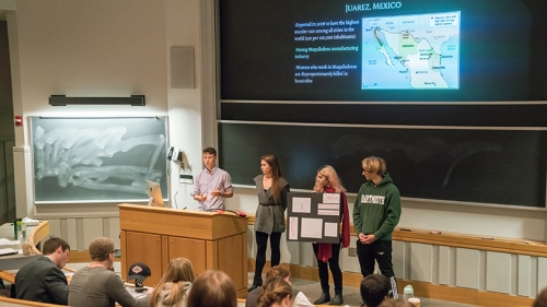 students giving a presentation in the Arts of War class