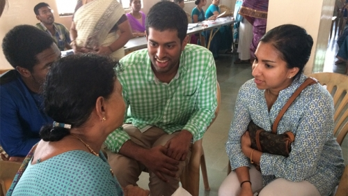 students interviewing a patient at an eye clinic in India