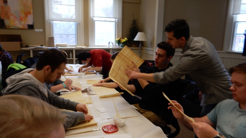 "Students in the spring '16 CLST 10 ""The Ancient Book: An Introduction to Paleography, Papyrology, Codicology, and Textual Criticism"" course use papyrus to construct scrolls as part of a multi-phase textual criticism project."