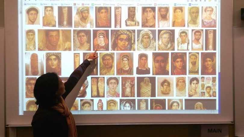 Dr. Suzanne Lye points out features of Fayum mummies in her Latin 1 course.
