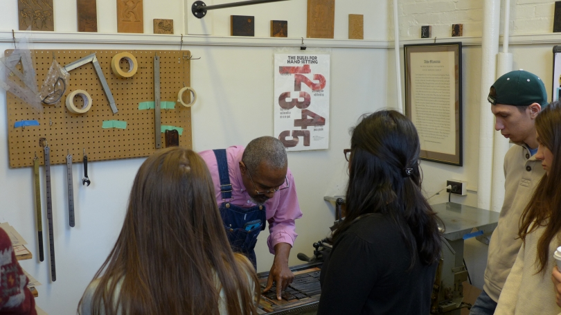 "Students in the spring '16 FILM 7 ""Mass Media and Democracy"" course learn the art of printmaking from master printer Amos Kennedy in the Dartmouth College Library's Book Arts Workshop."